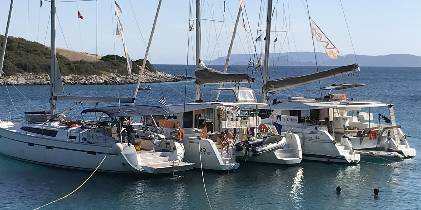 Flotilla of 2 Catamarans between Maddalena and Corsica. You're one of us?